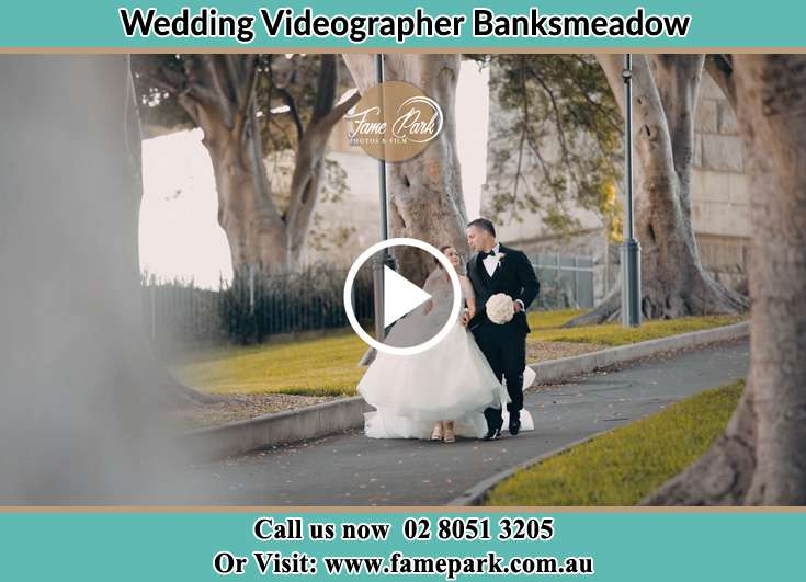 Bride and Groom walking at the park Banksmeadow NSW 2019