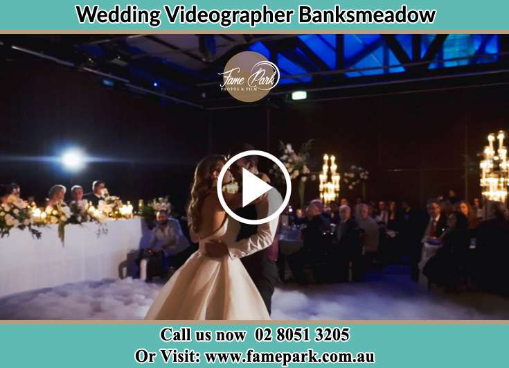 Bride and Groom looking at each other at the dance floor Banksmeadow NSW 2019