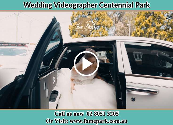 Bride getting out of the bridal car Centennial Park NSW 2021