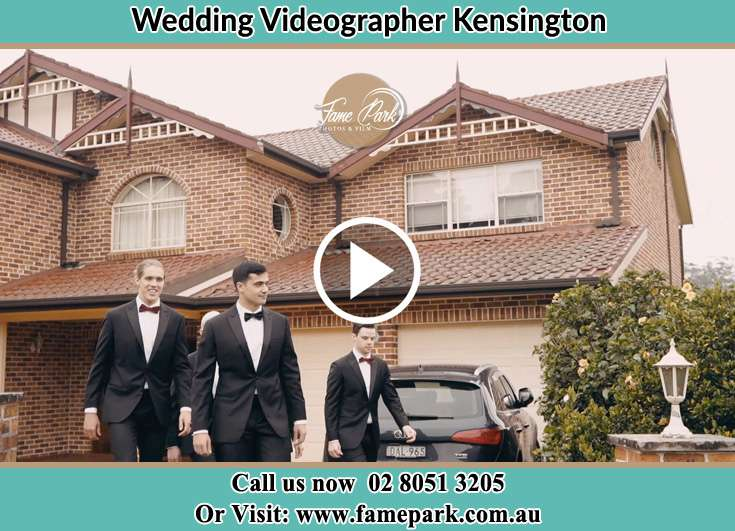 Groom walking at the house with his secondary sponsors Kensington NSW 2033
