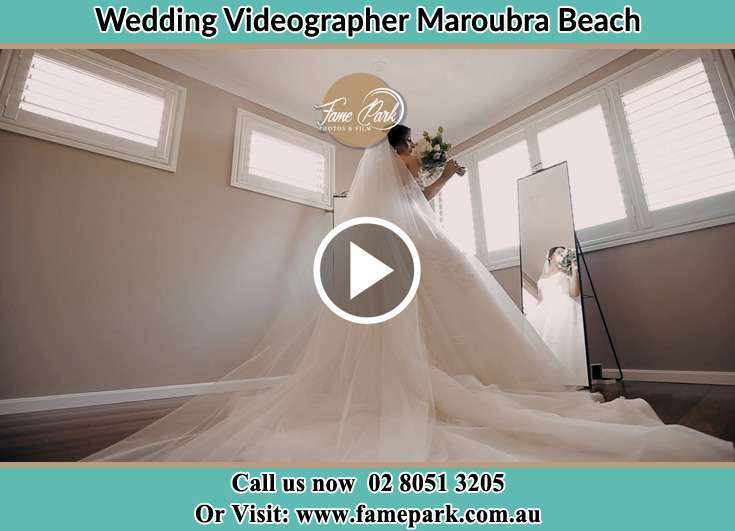 Bride in front of the mirror with bouquet of flowers Maroubra Beach NSW 2035