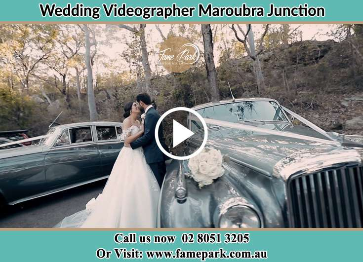 Bride and Groom kissed beside the bridal car Maroubra Junction NSW 2035