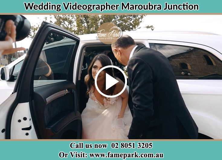 Bride getting out of the bridal car Maroubra Junction NSW 2035