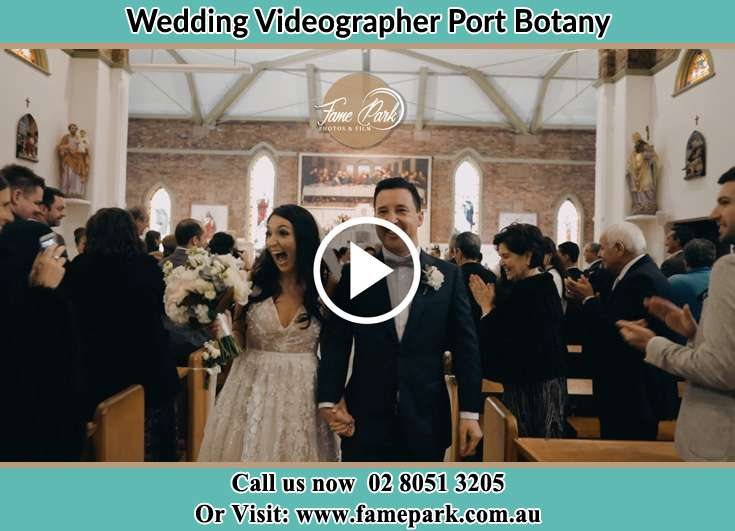 The newly weds leaving the altar as the crowd cheering at them Port Botany NSW 2036