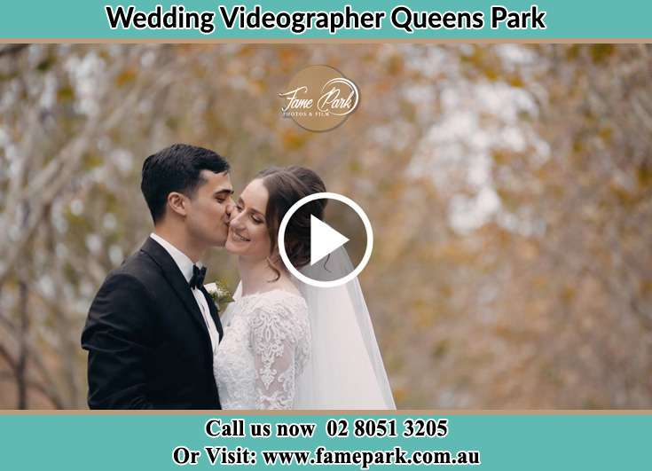 The Groom kissing the cheeks of his Bride Queens Park NSW 2022